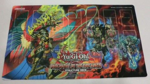 Duelists can win this new Game Mat in the Onslaught of the Fire Kings Structure Deck Tournament!